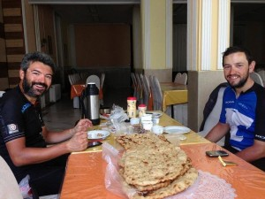 Reza and Steven enjoy local cuisine and a few moments off the bike.